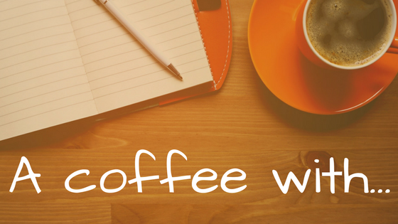 Image of coffee and notepad