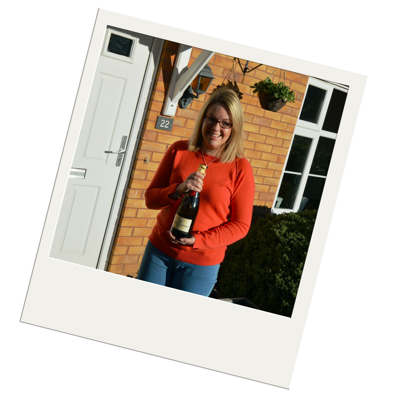 Leicester property valuation survey winner with champagne